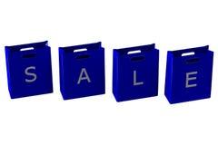 Sacchetti della spesa blu con la vendita di parola Immagini Stock