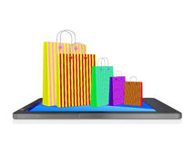 Sacchetti della spesa sullo Smart Phone del touch screen Fotografie Stock