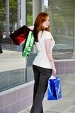 Sacchetti di acquisto della donna Immagini Stock