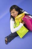 Sacchetti di acquisto della holding della donna Fotografia Stock
