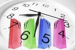 Sacchetti di acquisto e dell'orologio Fotografia Stock
