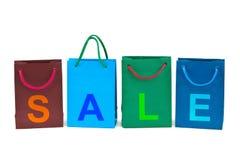 Sacchetti di acquisto e vendita di parola immagini stock