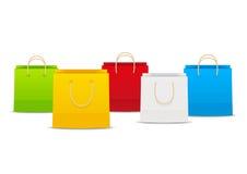Sacchetti di acquisto su bianco illustrazione vettoriale