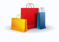 Sacchetti di acquisto su bianco Vettore Immagini Stock
