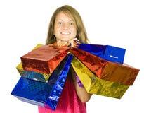 Sacchetti di acquisto teenager felici della holding della ragazza Fotografie Stock Libere da Diritti