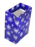 Sacchetto blu di carta con i fiocchi di neve Fotografia Stock Libera da Diritti