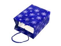 Sacchetto blu di carta con i fiocchi di neve Immagine Stock