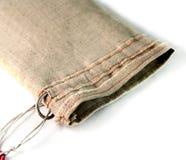 Sacchetto con i legami fatti del panno di tela grezzo Tessuto non dipinto, Fotografie Stock