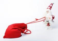 Sacchetto con i regali e Santa Fotografia Stock