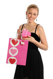 Sacchetto di acquisto della holding della giovane donna e contenitore di regalo Immagini Stock