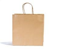 Sacchetto di acquisto di carta su bianco Fotografie Stock Libere da Diritti