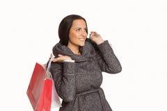 Sacchetto di acquisto sorridente della holding della donna Fotografie Stock