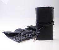 sacchetto di trucco o borsa del cosmetico su un fondo Immagine Stock
