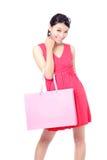 Sacchetto felice della holding della ragazza di acquisto Immagini Stock Libere da Diritti