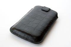 Sacchetto nero per il telefono su una priorità bassa bianca Fotografie Stock Libere da Diritti