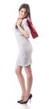 Sacchetto rosso d'acquisto della stretta della giovane donna. Sconto Immagine Stock