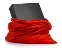 Sacchetto rosso del Babbo Natale con la scatola nera del regalo Fotografie Stock