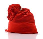 Sacchetto rosso del Babbo Natale in pieno, su priorità bassa bianca Fotografia Stock Libera da Diritti