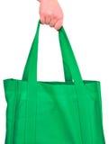 Sacchetto verde riutilizzabile di trasporto Fotografie Stock