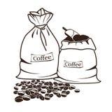 Sacchi di caffè e dei chicchi di caffè Fotografie Stock