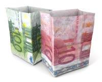 Sacchi di carta dieci e cento euro Immagine Stock
