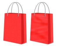 Sacchi di carta rossi di acquisto di Kraft Fotografia Stock Libera da Diritti