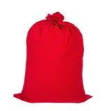 Sacco chiuso rosso di Natale di Santa in pieno dei regali isolati sul whi Fotografie Stock