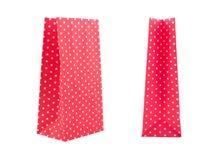 Sacco di carta rosso isolato su fondo bianco Fotografia Stock