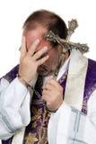 Sacerdote católico com algemas. Abuso. Fotografia de Stock