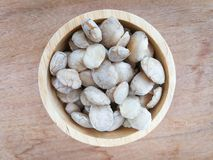 Sacha inchi seeds. In wood cup royalty free stock images