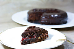 Rich chocolate cake, With almonds and raspberry jam. Royalty Free Stock Photography