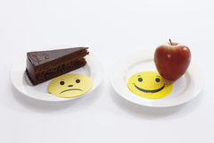Sacher cake slice and apple on plates Royalty Free Stock Photography
