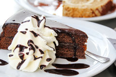 Sacher Cake. Vienna sweets specialty: Sacher Cake with decorative cream Royalty Free Stock Image