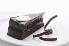Free Sacher Torte, Chocolate Tart With Swirls On White Plate, Sweet Dessert, Patisserie, Photography For Shop Stock Photo - 65299020