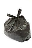 Sachet en plastique noir avec des déchets Image libre de droits