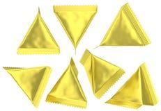 Sachet en plastique tétraédrique d'aluminium d'or Photographie stock