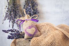 Sachet with Lavender on the rustic background stock photography
