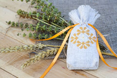 Sachet with ukrainian embroidery, sheaf of wheat and dried herbs Royalty Free Stock Photo