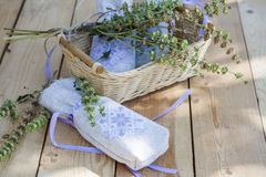 Sachet with ukrainian embroidery, sheaf of wheat and dried herbs on wooden background Stock Photography