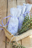 Sachet with ukrainian embroidery, sheaf of wheat and dried herbs on wooden background Stock Images
