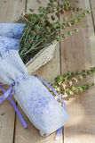 Sachet with ukrainian embroidery, sheaf of wheat and dried herbs on wooden background Royalty Free Stock Images