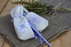 Sachet with ukrainian embroidery, sheaf of wheat and dried herbs on wooden background Royalty Free Stock Photography
