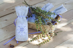 Sachet with ukrainian embroidery, sheaf of wheat and dried herbs on wooden background Royalty Free Stock Image