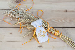 Sachet with ukrainian embroidery, wheat and oat on wooden background Royalty Free Stock Photography