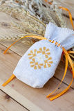 Sachet with ukrainian embroidery, wheat and oat on wooden background Royalty Free Stock Image