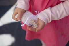 Sachet of white rice on child hands Stock Photo