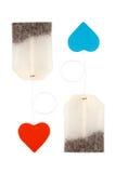 Sachets à thé avec les étiquettes en forme de coeur Images libres de droits