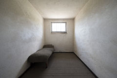 Sachsenhausen concentration camp. Single bed in a prison cell in Sachsenhausen concentration camp, Oranienburg, Germany stock images