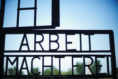 Arbeit macht frei Sign. Sachsenhausen Oranienburg in Germany. Concentration camp memorial site Royalty Free Stock Photo