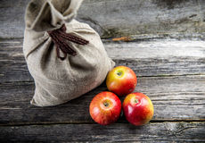 Sack and apples Stock Photo